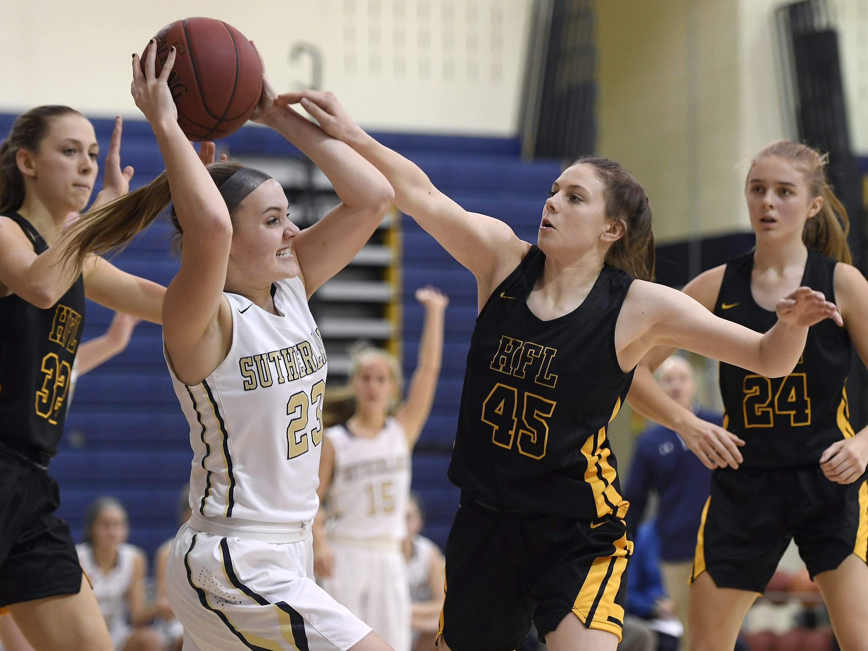 Pittsford Sutherland's Abby Creary, left, looks to pass while defended by HF-L's Morgan Bellavia during a regular season game played at Pittsford Sutherland High School on Thursday, Nov. 29, 2018. Pittsford Sutherland beat Honeoye Falls-Lima in overtime 53-47.