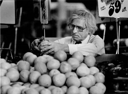 1980:Manager John Jaconski is shown at the Irondequoit Park Edge supermarket.