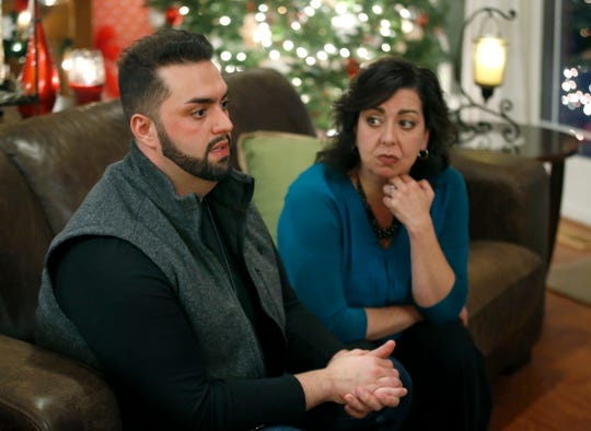 John Nucci with his mother Daneane during an interview at their home in Greece. John was addicted for two years to OxyContin and now he wants to attend law school to help people in the situation he was in.