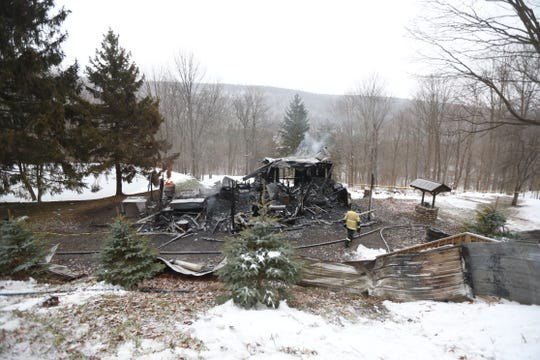 Very little of a ranch house on County Road 33 in South Bristol was left after a fire raged overnight Thursday, leaving two people dead inside the structure.