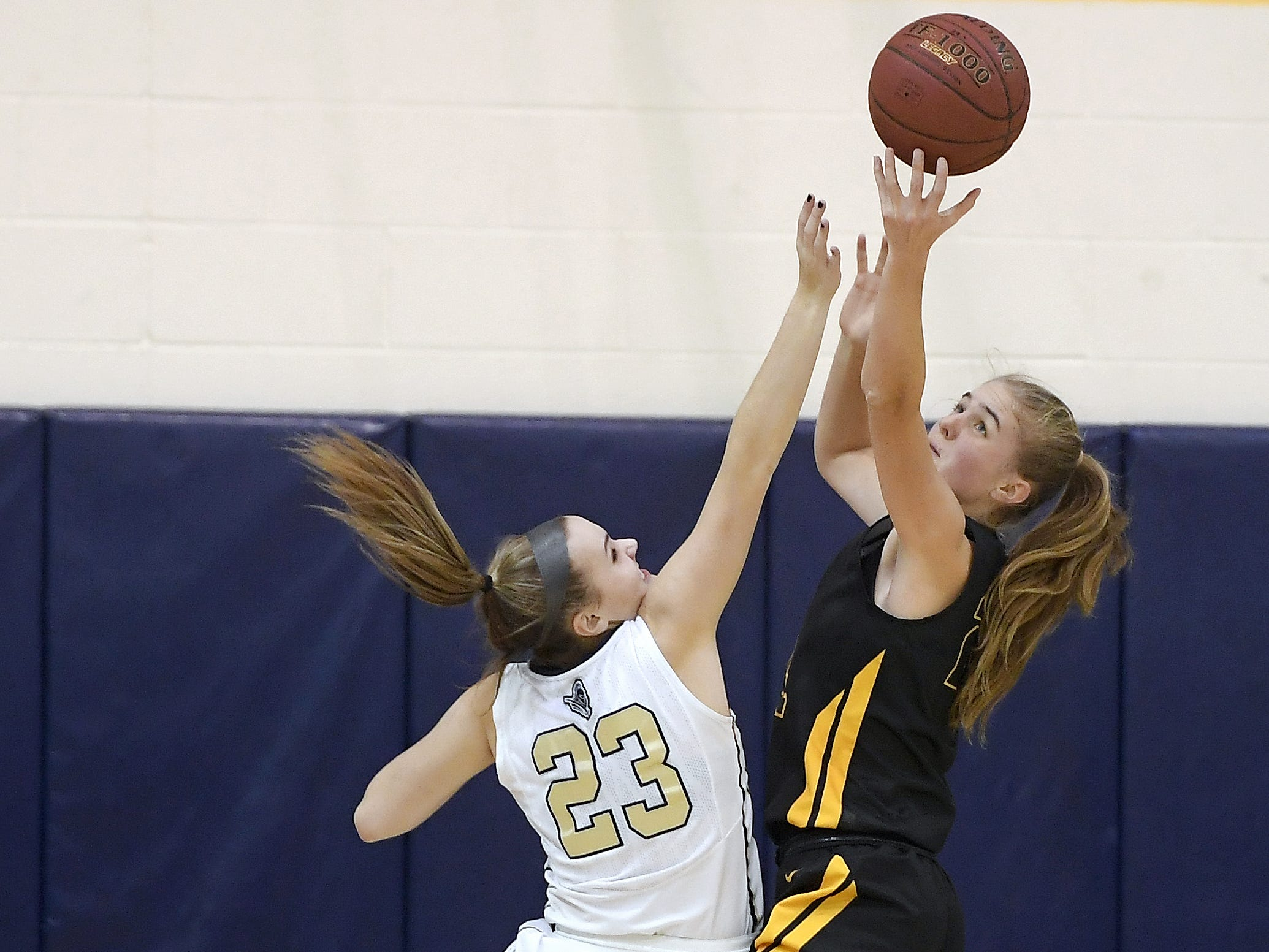 Pittsford Sutherland's Abby Creary, left, and HF-L's Teagan Kamm reach for a rebound during a regular season game played at Pittsford Sutherland High School on Thursday, Nov. 29, 2018. Pittsford Sutherland beat Honeoye Falls-Lima in overtime 53-47.