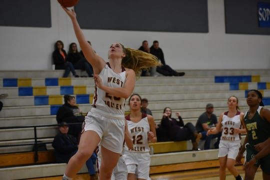 West Valley senior Jenna Adkins attempts a layup against St. Patrick- St. Vincent on Thursday, Nov. 29.