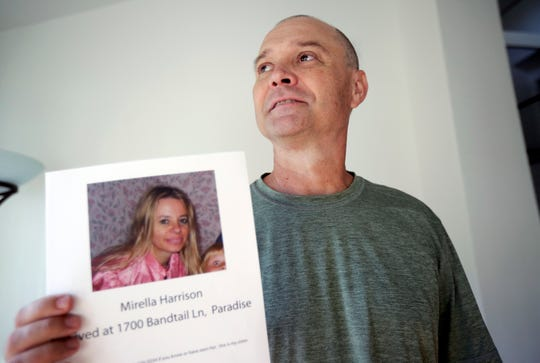 In this Nov. 27, 2018, photo, Bill Engfelt poses for a portrait holding the flyer he made while searching for information on his sister, Mirella Harrison, in Solana Beach, Calif. Engfelt and his sister hadn't been in close contact for years when a fire blew through her hometown of Paradise, Calif. After a lengthy search, she was found safe. He's happy to have found his sister, but frustrated at what he felt was a confusing process to locate her. (AP Photo/Gregory Bull)