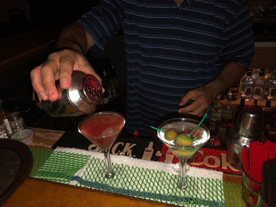 Bartender Houston Engelhardt makes a martini and a Cosmopolitan at Jack's Grill.