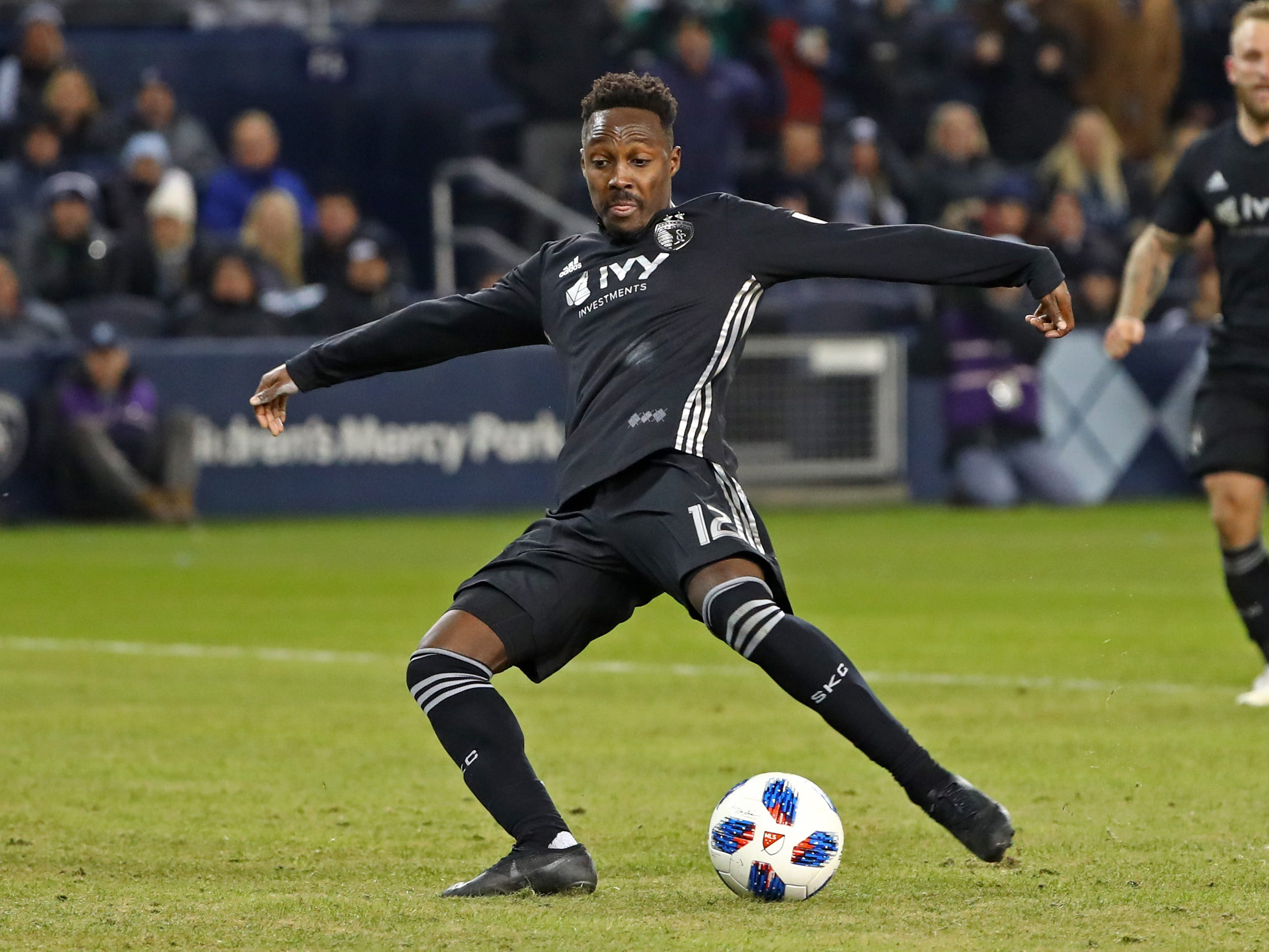 Nov 29, 2018; Kansas City, KS, USA; Sporting Kansas City forward Gerso (12) scores a goal against the Portland Timbers during the second half in the second leg of the MLS Western Conference Championship at Children's Mercy Park. Mandatory Credit: Jay Biggerstaff-USA TODAY Sports