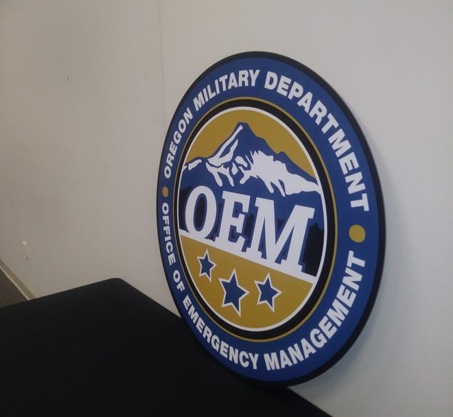A logo of the Oregon Office of Emergency Management at the office's headquarters in Salem. The state office and Federal Emergency Management Agency are working more closely together.