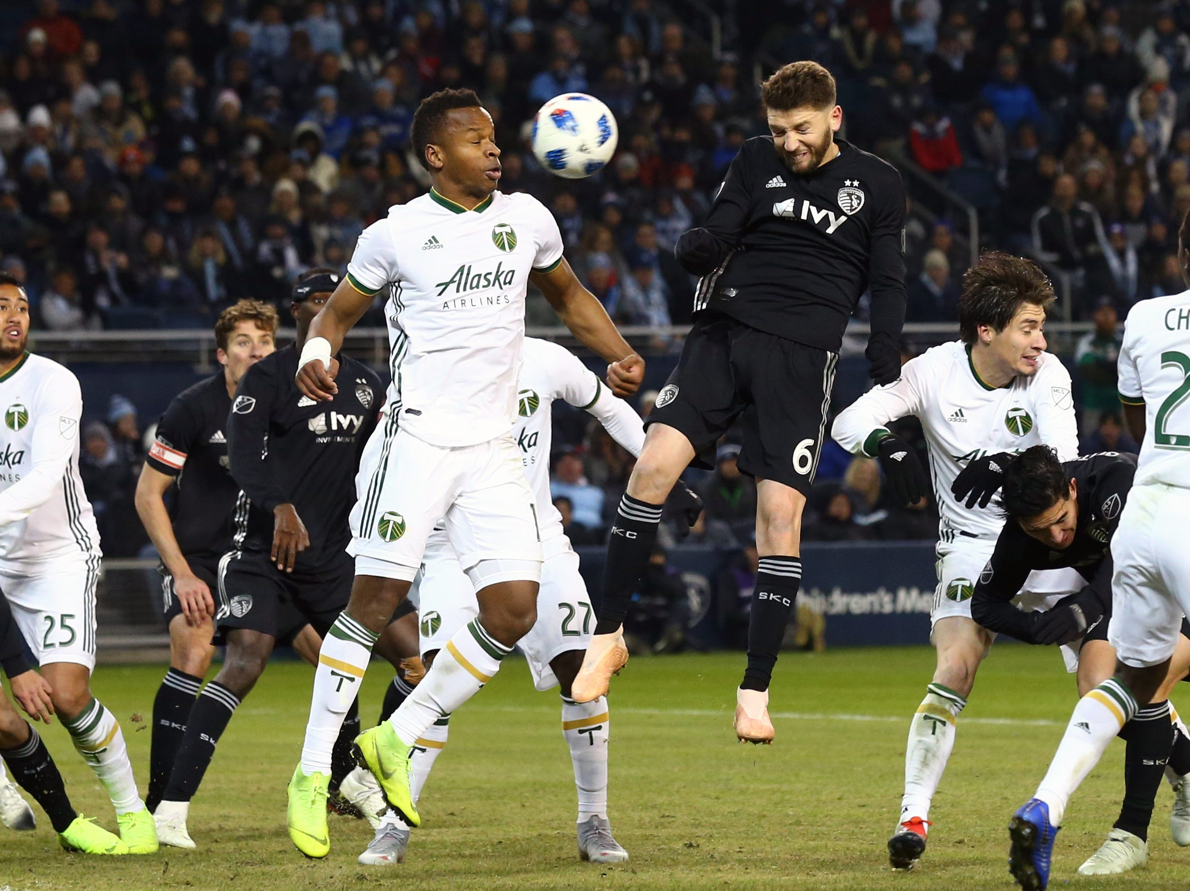 Nov 29, 2018; Kansas City, KS, USA; Sporting Kansas City midfielder Ilie Sanchez (6) heads a ball against Portland Timbers forward Jeremy Ebobisse (17) during the second half in the second leg of the MLS Western Conference Championship at Children's Mercy Park. Mandatory Credit: Jay Biggerstaff-USA TODAY Sports