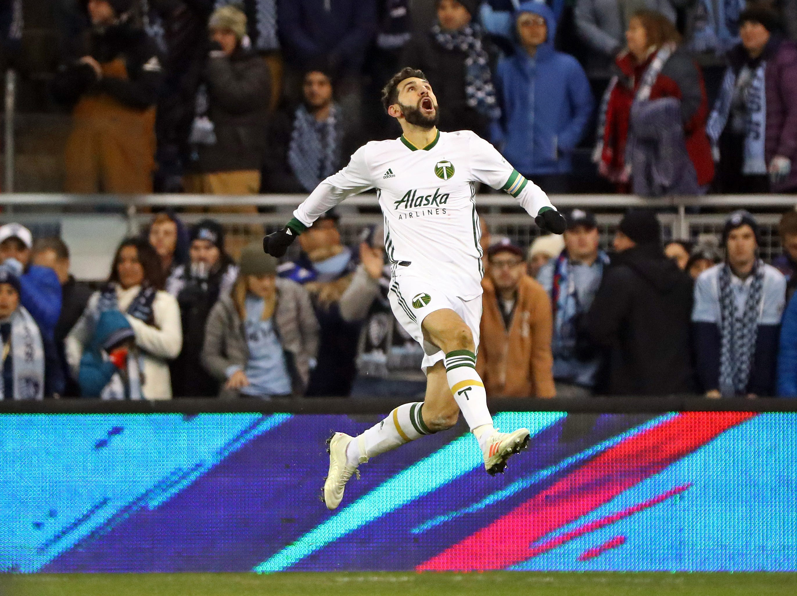 Nov 29, 2018; Kansas City, KS, USA; Portland Timbers midfielder Diego Valeri (8) celebrates after scoring a goal against the Sporting Kansas City during the second half in the second leg of the MLS Western Conference Championship at Children's Mercy Park. Mandatory Credit: Jay Biggerstaff-USA TODAY Sports