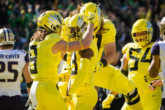 Oct 13, 2018; Eugene, OR, USA; Oregon Ducks wide receiver Dillon Mitchell (13) celebrates with teammates after scoring a touchdown during the first half against the Washington Huskies at Autzen Stadium. Mandatory Credit: Troy Wayrynen-USA TODAY Sports