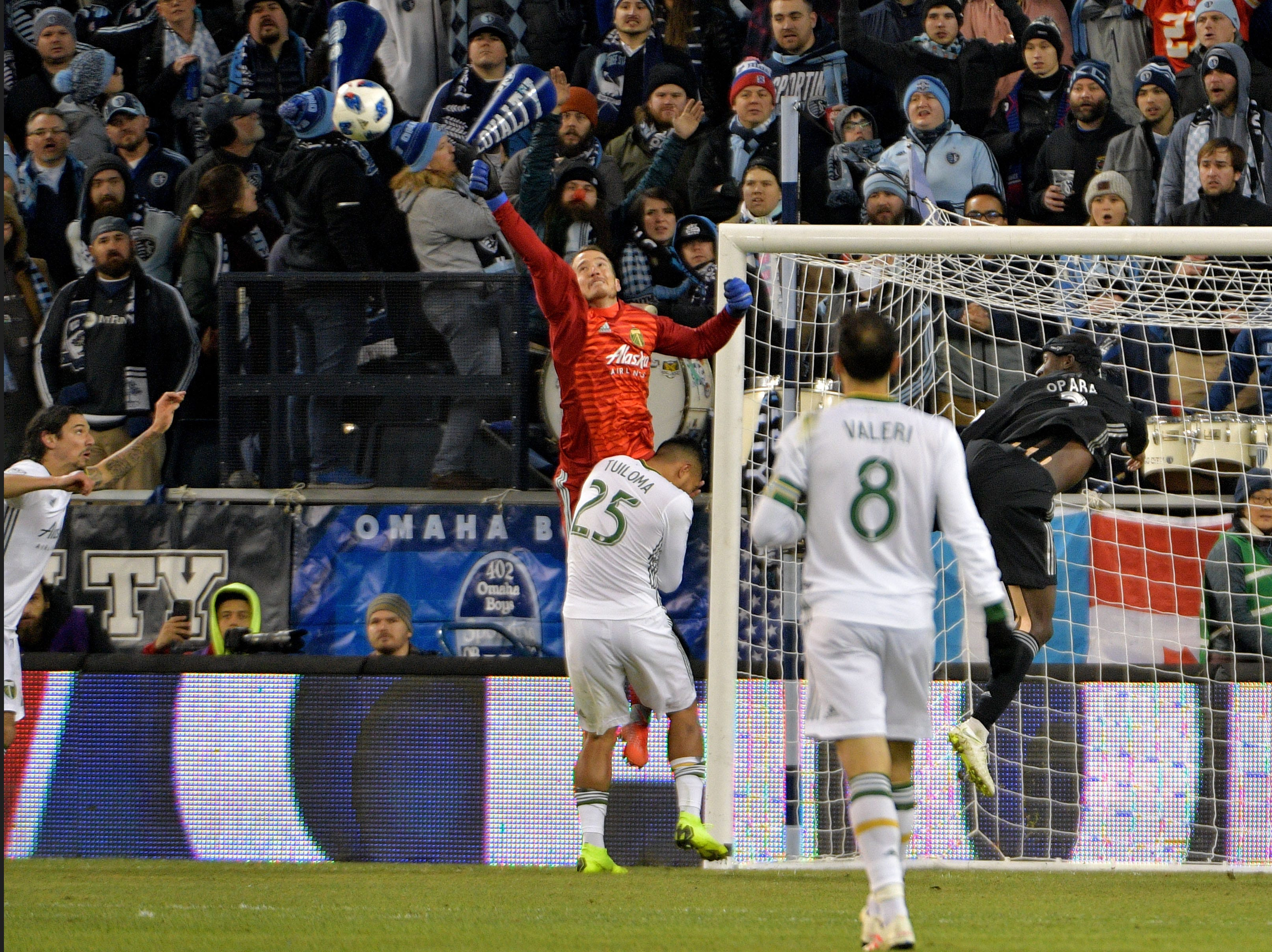 Nov 29, 2018; Kansas City, KS, USA; Portland Timbers goalkeeper Jeff Attinella (1) punches out a shot on goal from Sporting Kansas City defender Ike Opara (3) in the second leg of the MLS Western Conference Championship at Children's Mercy Park. Mandatory Credit: Denny Medley-USA TODAY Sports