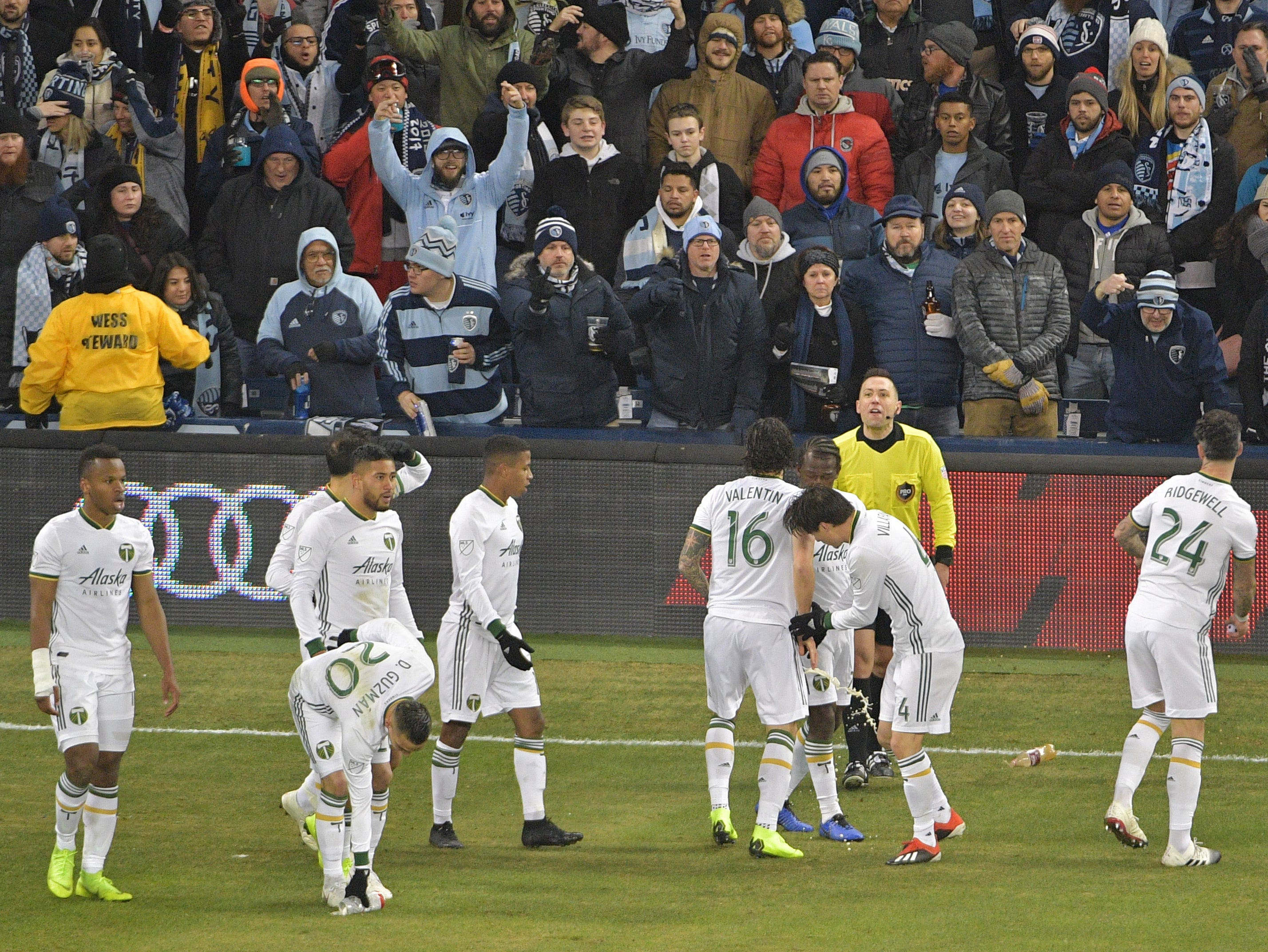 Nov 29, 2018; Kansas City, KS, USA; (Editor's Note: Obscene Gestures) Fans throw bottles on field after a Portland Timbers score in a game against Sporting Kansas City in the second leg of the MLS Western Conference Championship at Children's Mercy Park. Mandatory Credit: Denny Medley-USA TODAY Sports