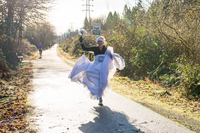 Angela Watts of Salem ran the Resolution Relay in her wedding dress in Boring, Oregon, on New Years Eve 2017. She had promised to run in the Dressember race in her dress if she reached her $3,000 fundraising goal.