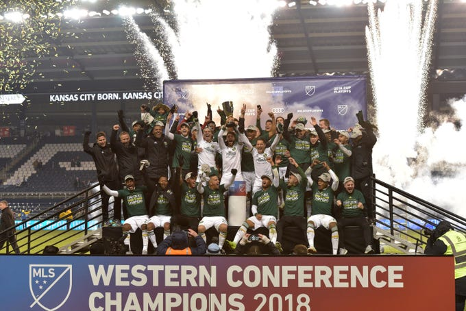 Nov 29, 2018; Kansas City, KS, USA; The Portland Timbers team celebrate with the trophy after defeating Sporting Kansas City in the second leg of the MLS Western Conference Championship at Children's Mercy Park. Mandatory Credit: Denny Medley-USA TODAY Sports