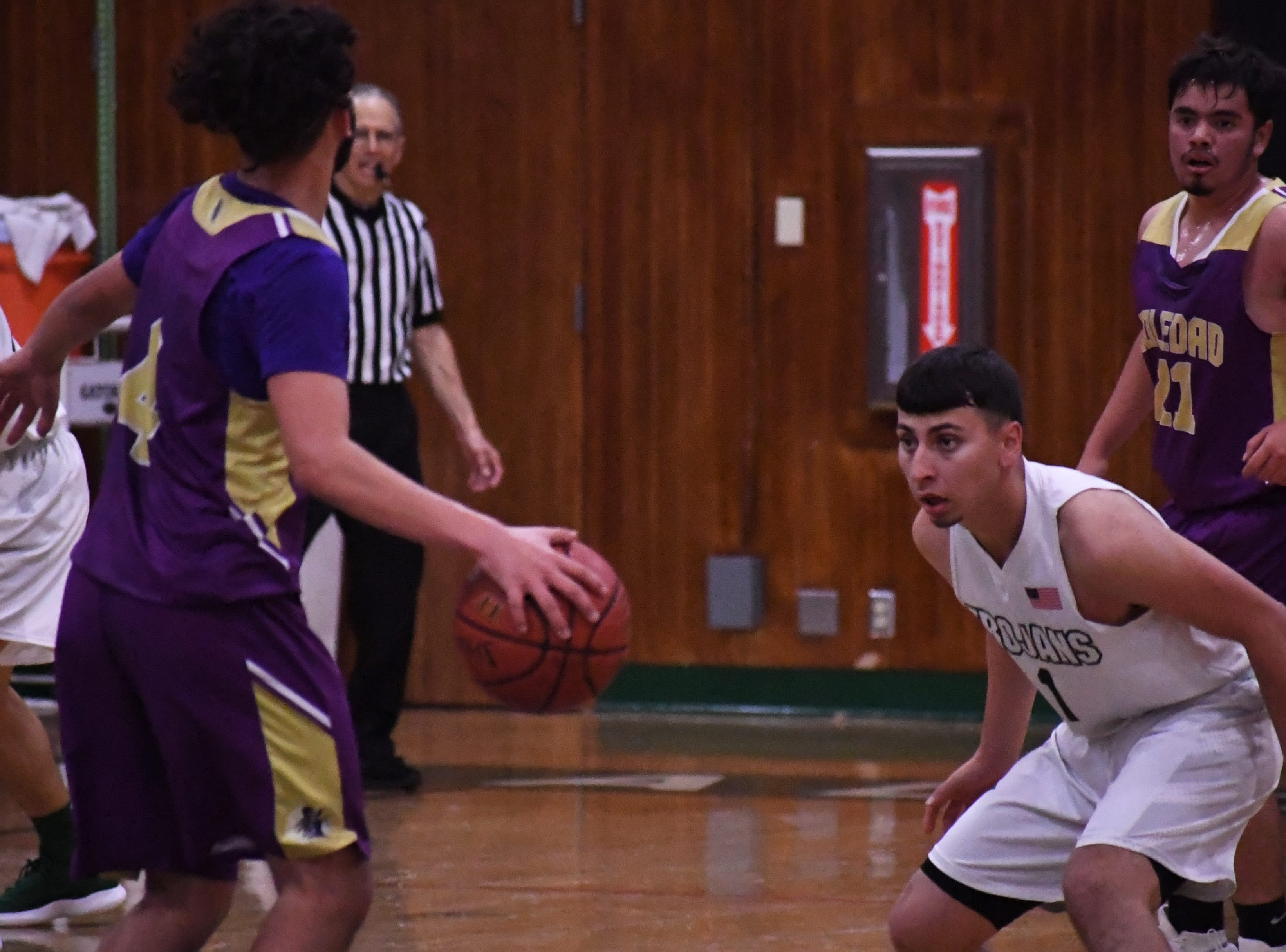 Guard Danny Martinez (1) stays in front of his man on defense.