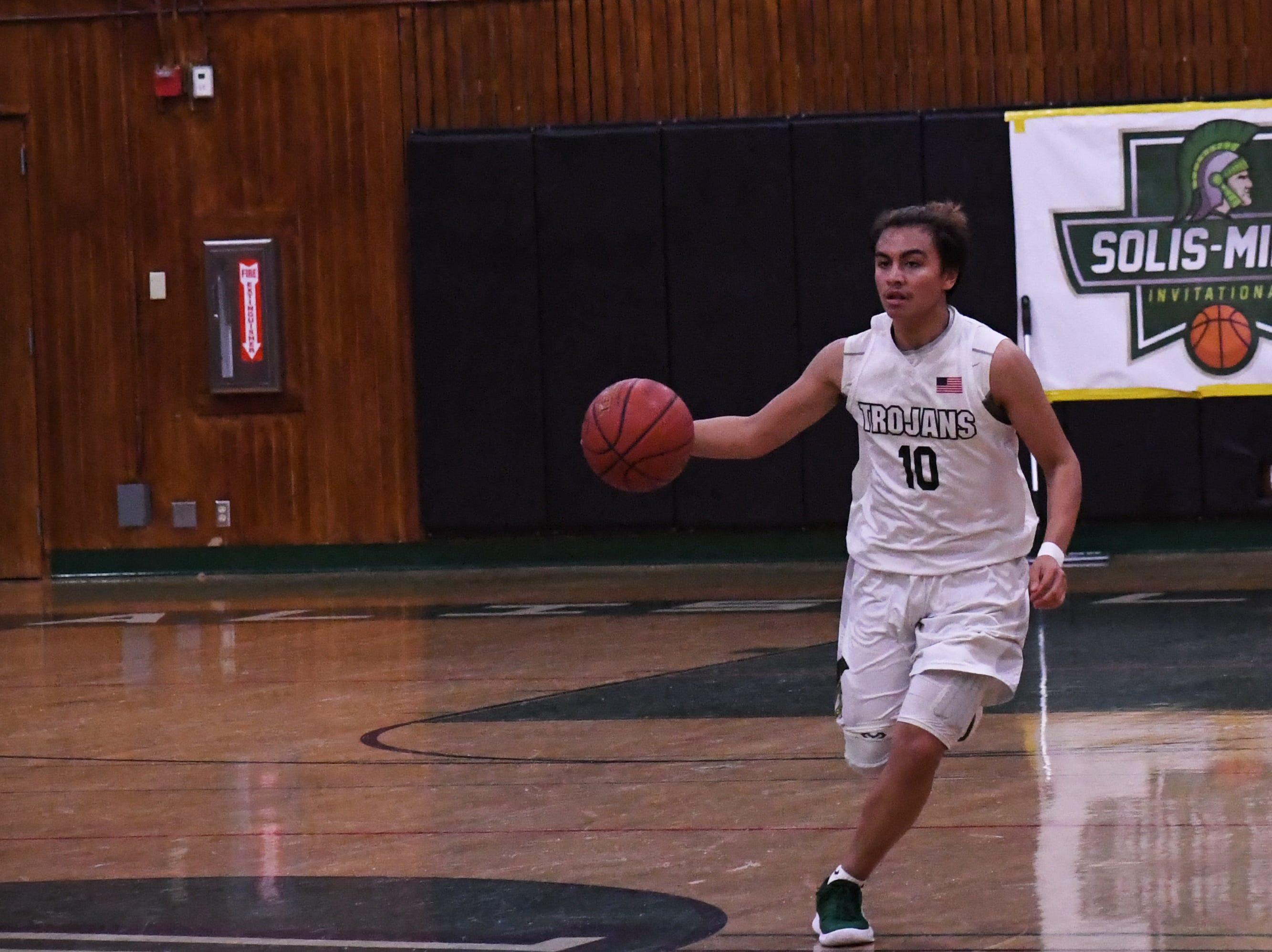 Guard Vincent Gonzalez (10) dribbles a fast-break past half court.