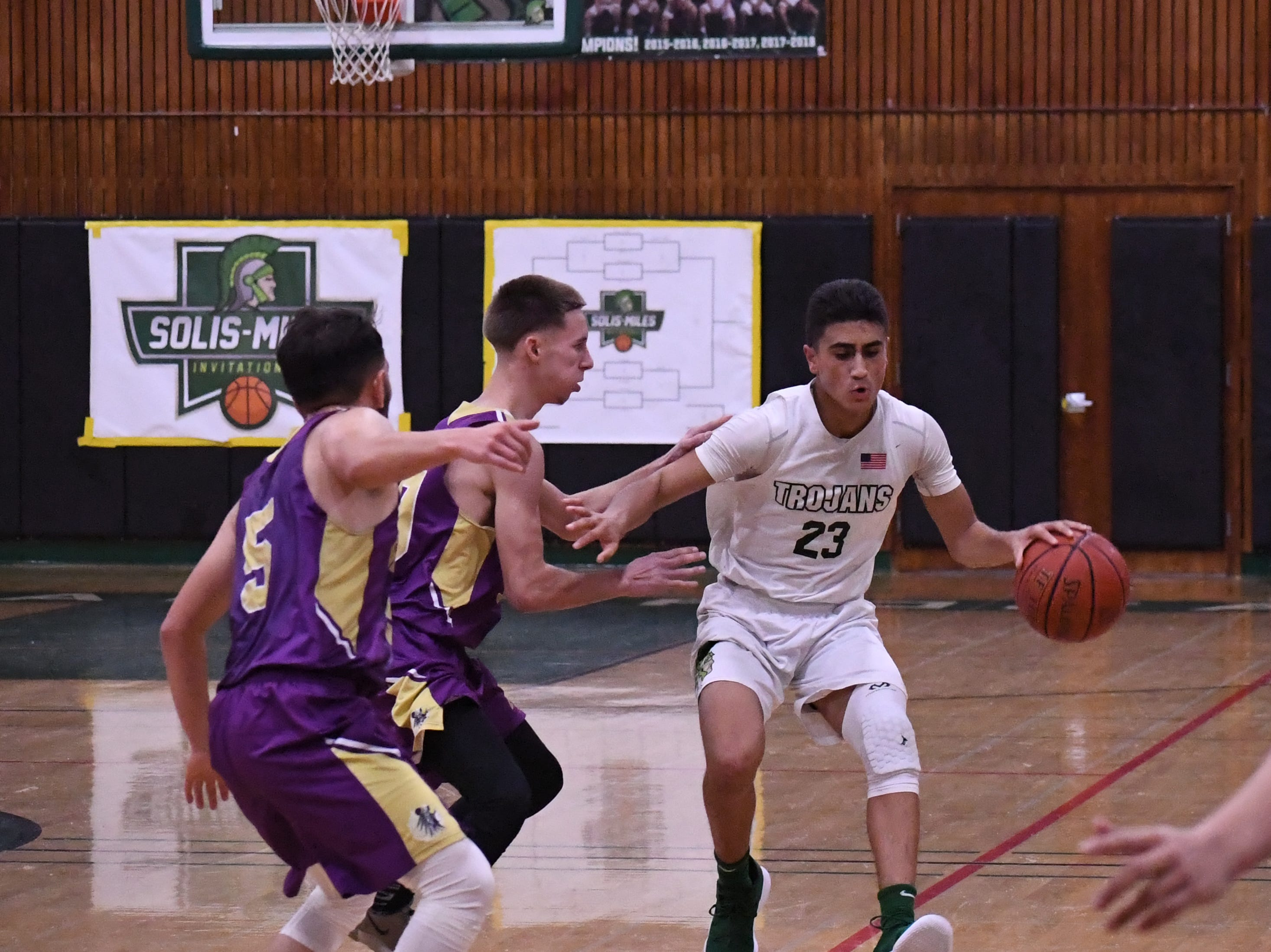 Guard Josue Gil-Silva (23) stops to reverse direction against a double-team.