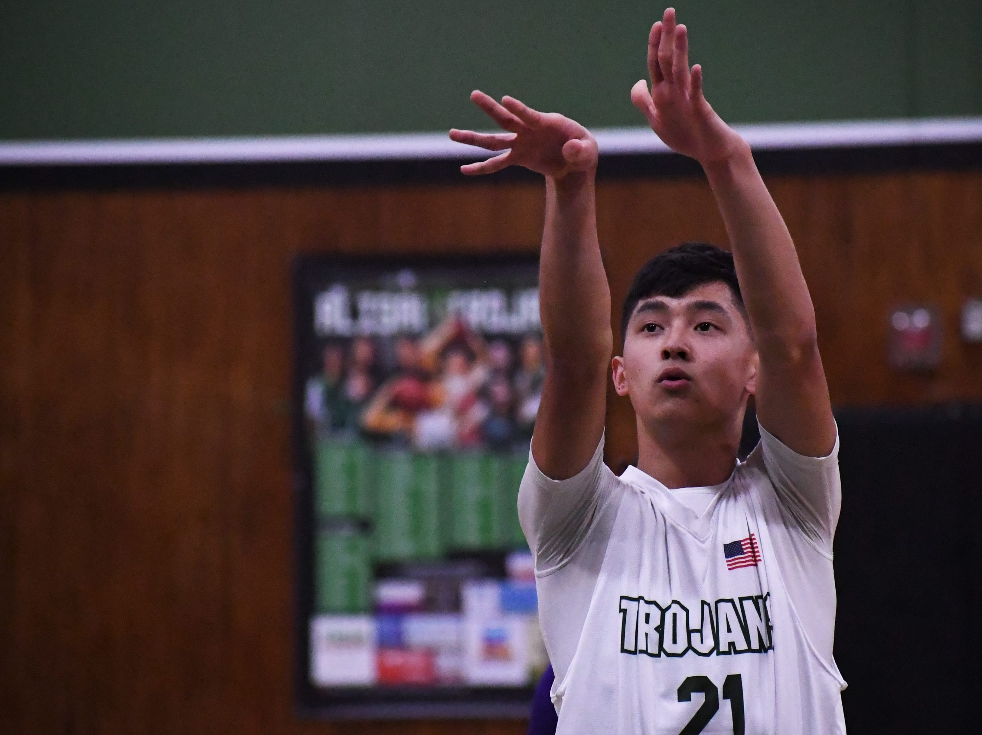 Junior Shawn Vuong (21) releases a free throw during the second quarter.