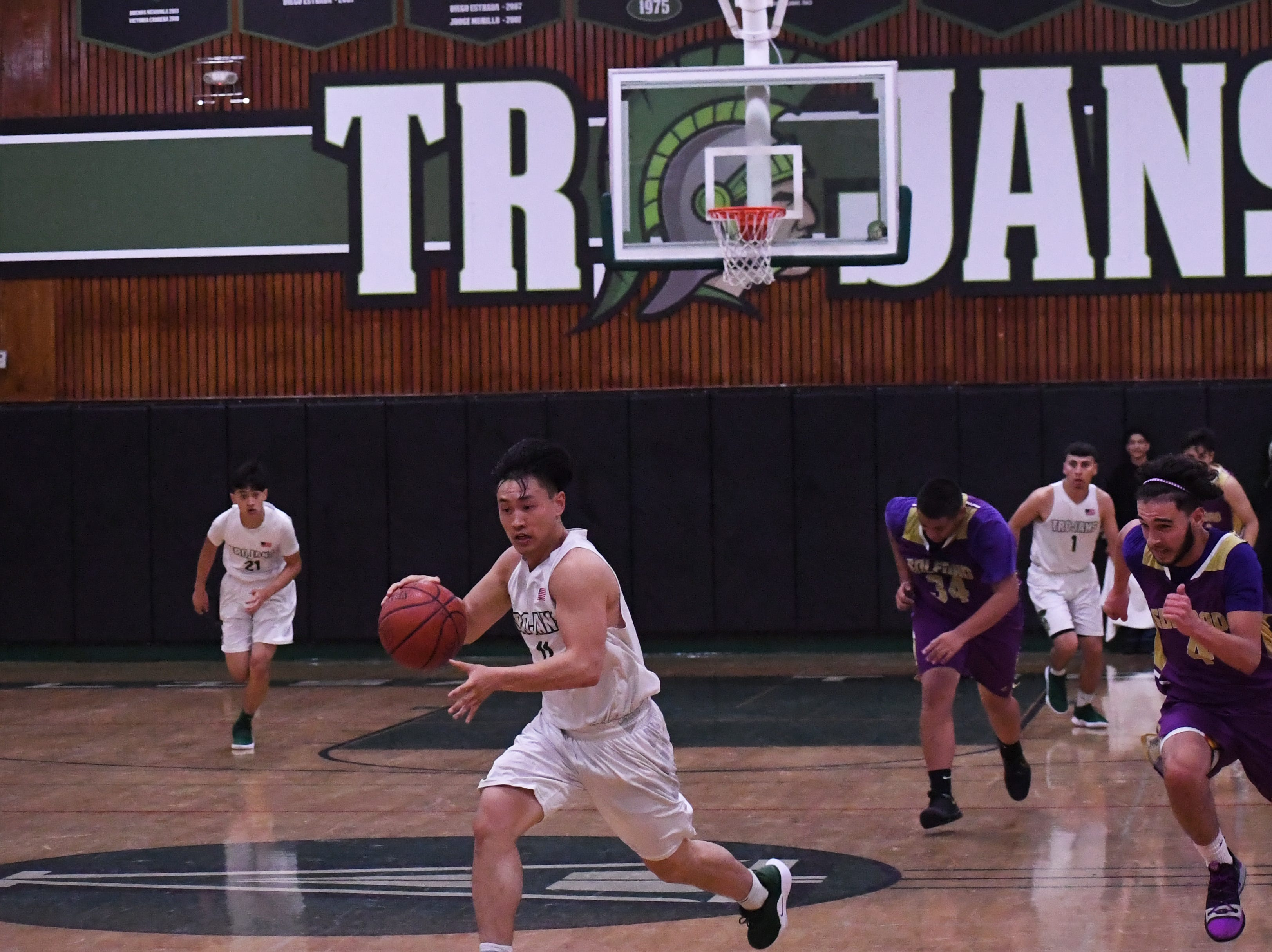 Guard Joshua Vuong (11) sprints to the hoop after getting a steal.