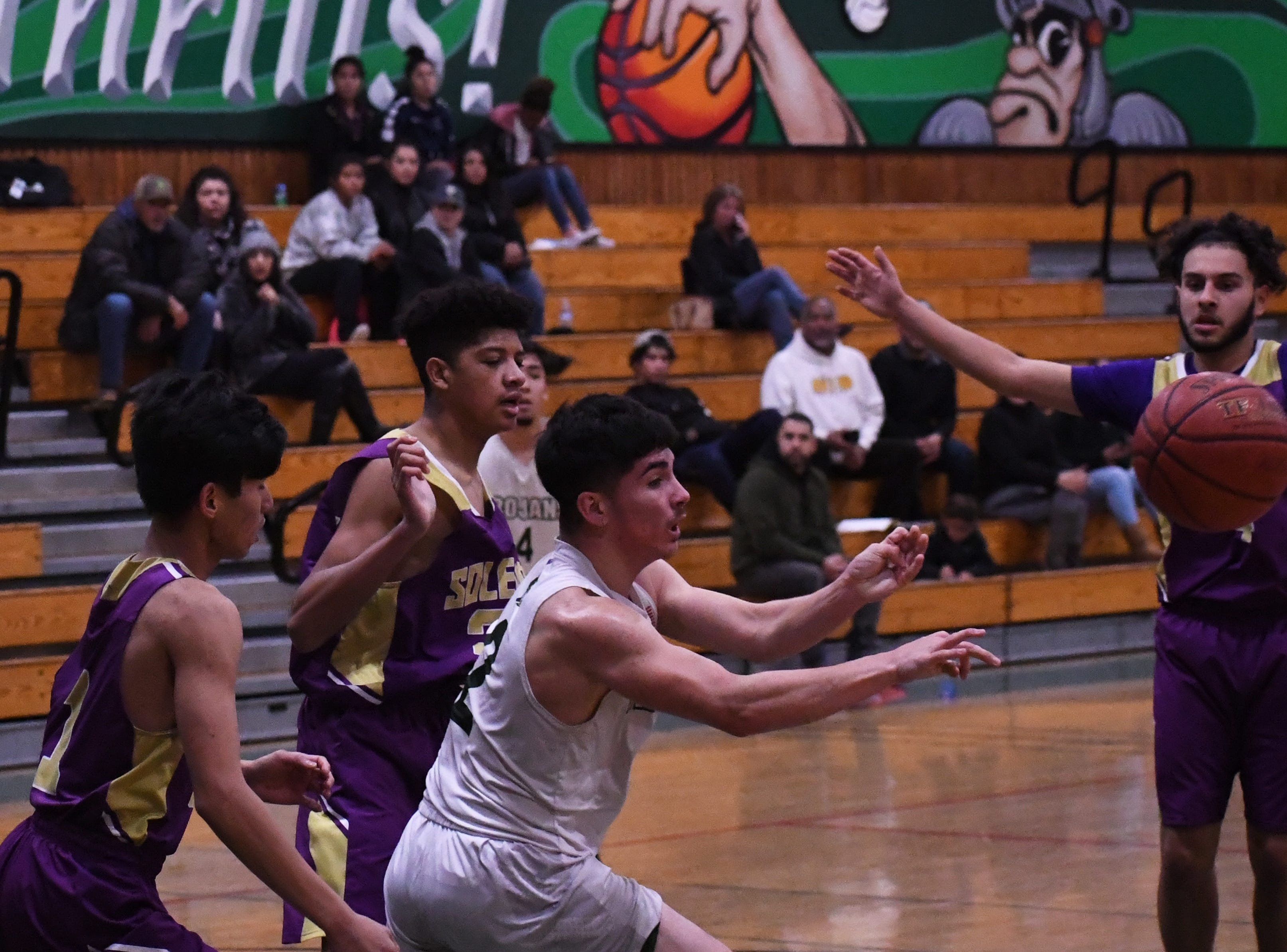 Forward Ulisses Mendoza (2) fires a pass out of the lane.