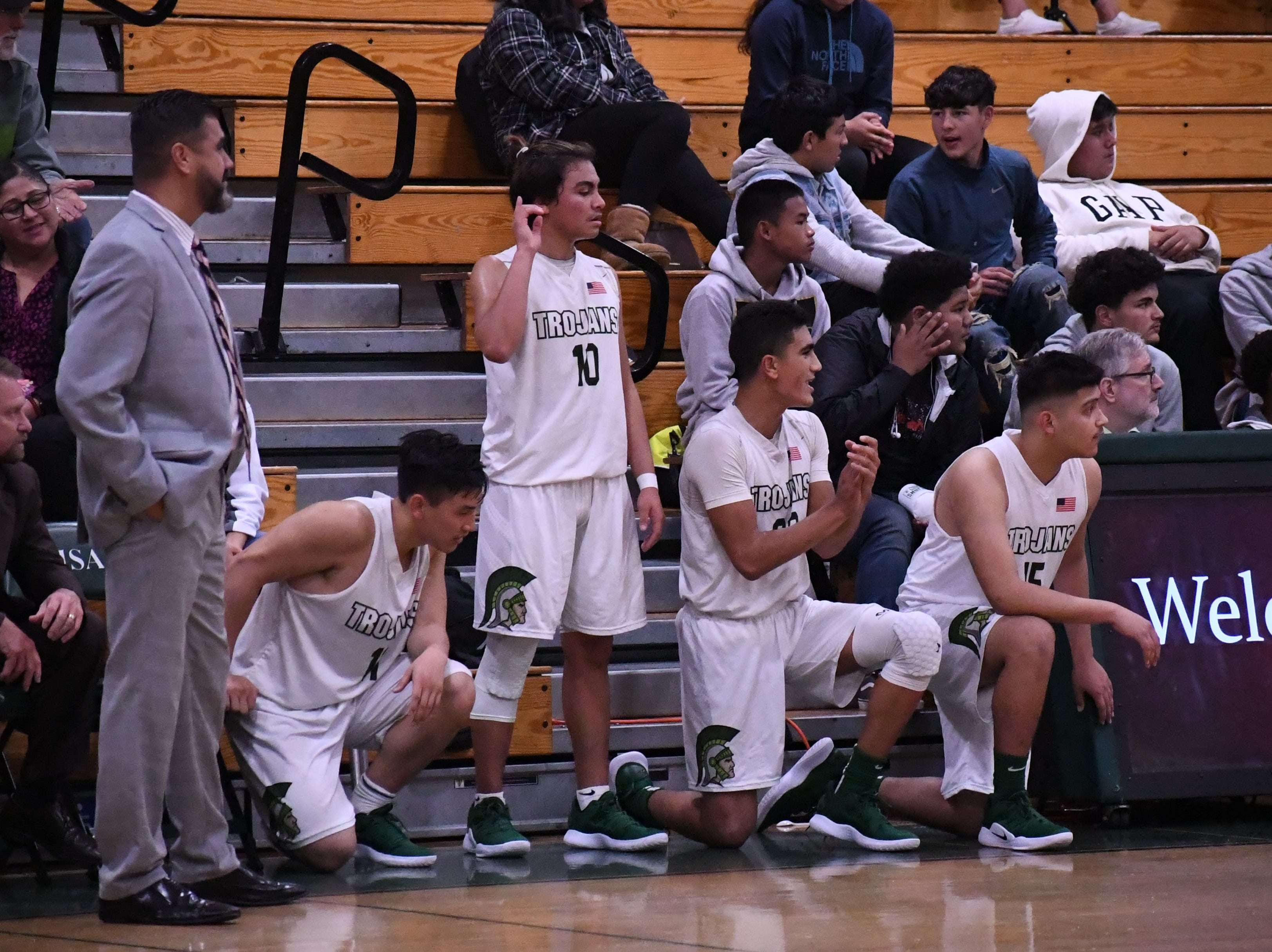Coach Jose Gil watches as guards Joshua Vuong (11), Vincent Gonzalez (10) and Josue Gil-Silva (23) and forward Alex Maravillo (15) wait to check in to the game.