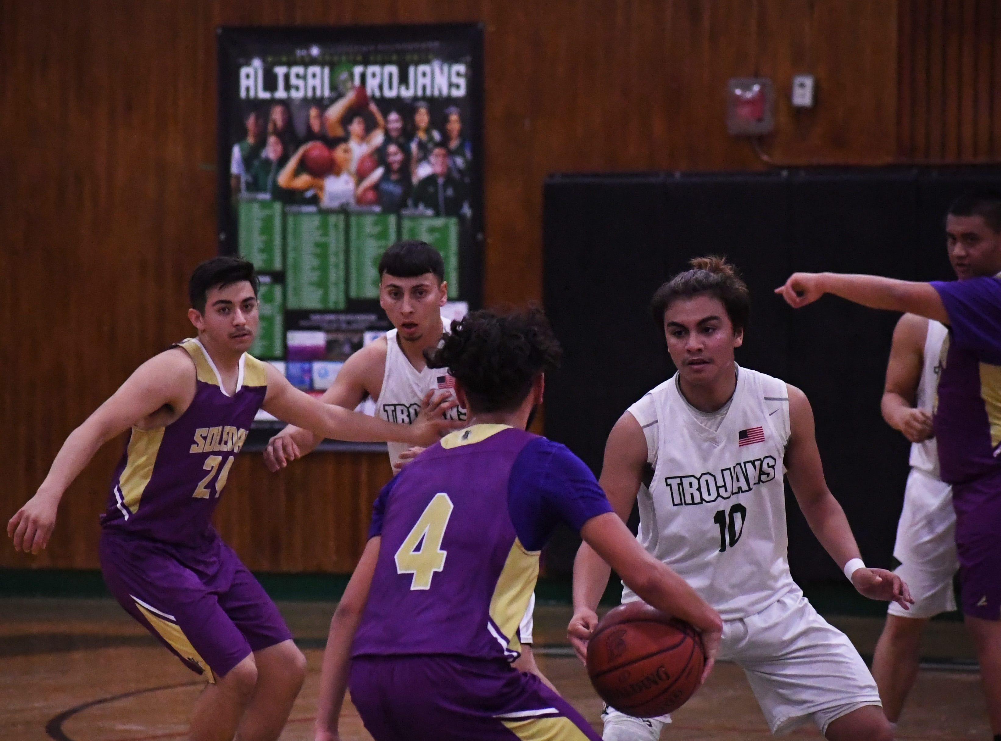 Guard Vincent Gonzalez (10) tracks his man on defense.