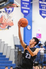 Lake View's Ryan Avalos jumps to make a shot against Del Valle during the Doug McCutchen Basketball Tournament Thursday, Nov. 29, 2018, at Central High School.