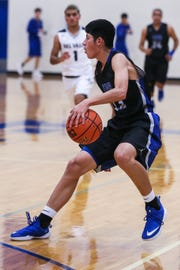 Lake View's Ryan Avalos dribbles against Del Valle during the Doug McCutchen Basketball Tournament Thursday, Nov. 29, 2018, at Central High School.