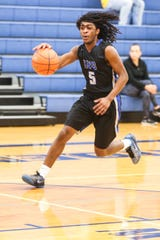 Lake View's Ahmad Daniels dribbles towards the basket during the game against Del Valle during the Doug McCutchen Basketball Tournament Thursday, Nov. 29, 2018, at Central High School.