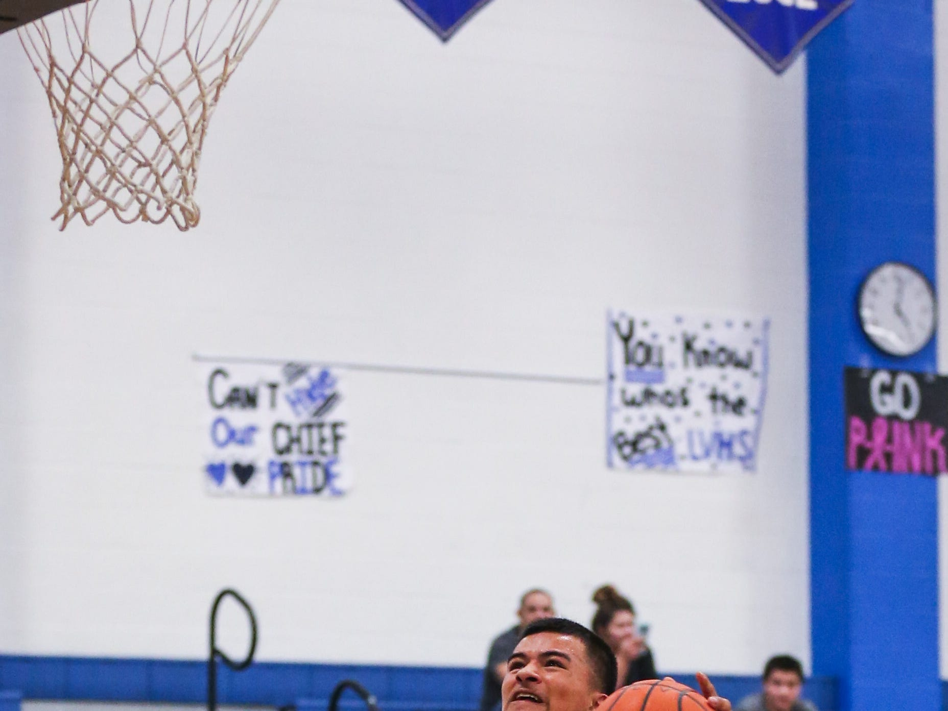 Lake View's Johnny Espinosa jumps to make a shot against Del Valle during the Doug McCutchen Basketball Tournament Thursday, Nov. 29, 2018, at Central High School.