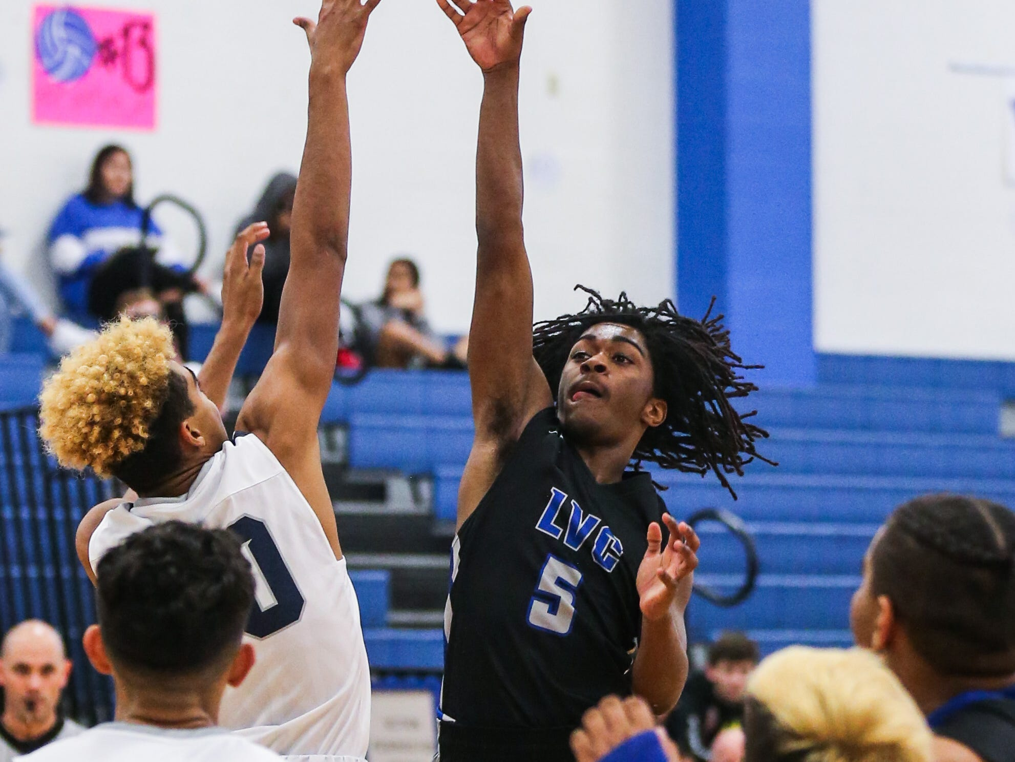 Lake View's Ahmad Daniels jumps to make a shot against Del Valle during the Doug McCutchen Basketball Tournament Thursday, Nov. 29, 2018, at Central High School.