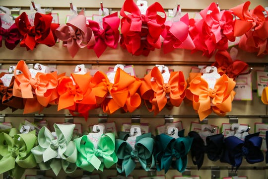 A wall of bows on display at Fancy Pants Children's Boutique in San Angelo.