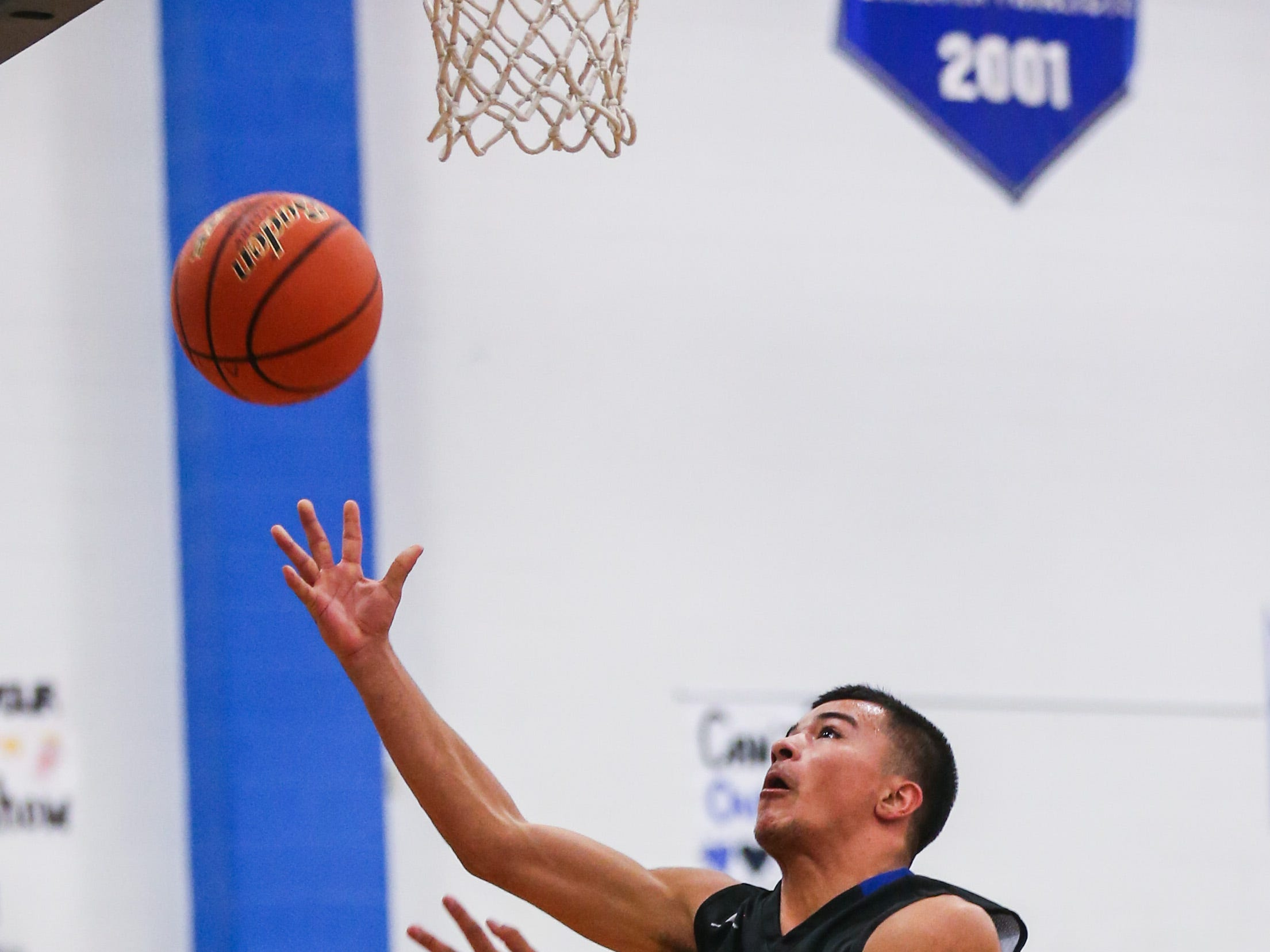 Lake View's Johnny Espinosa jumps for the rebound against Del Valle during the Doug McCutchen Basketball Tournament Thursday, Nov. 29, 2018, at Central High School.