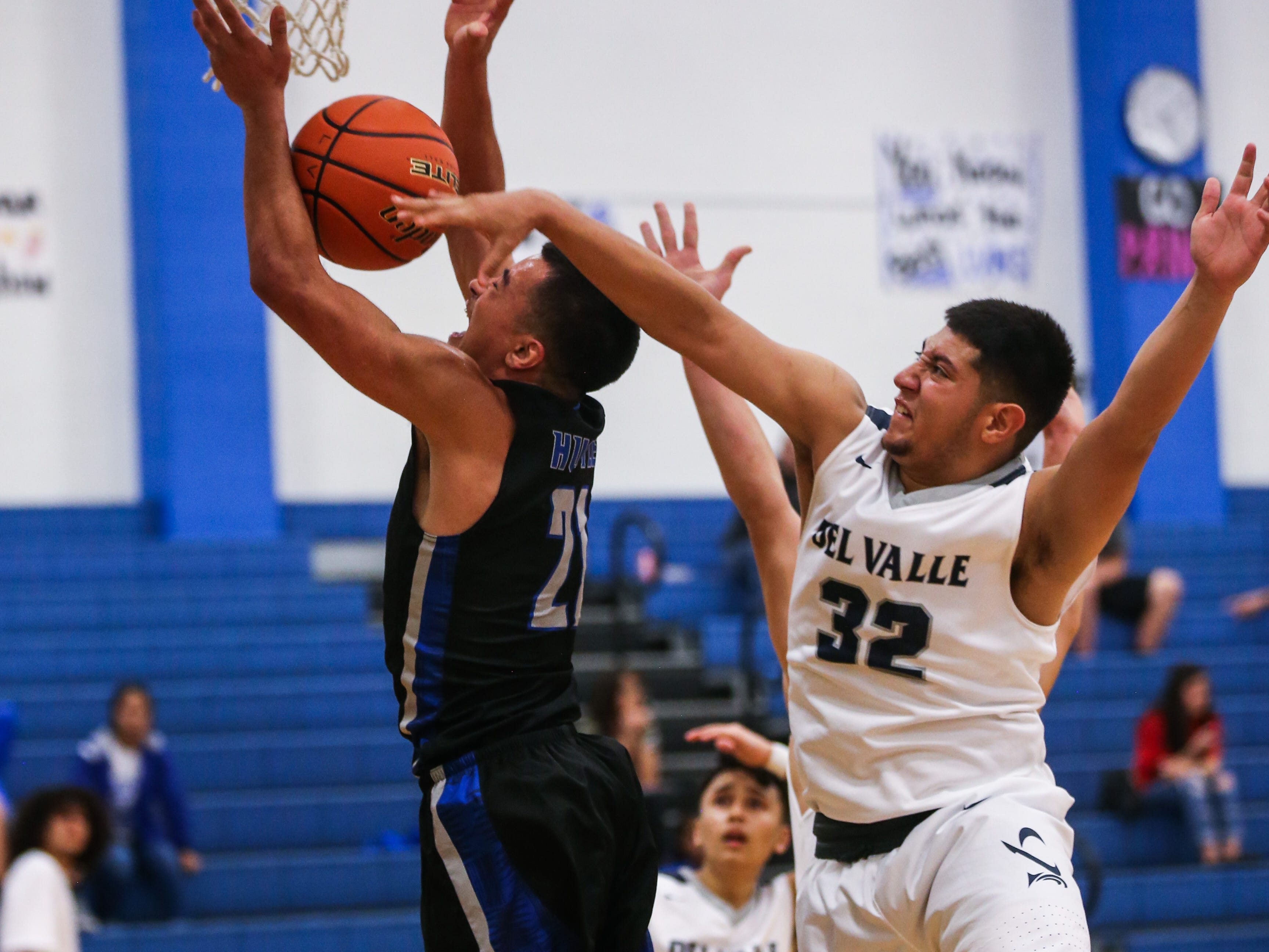 Lake View's Johnny Espinosa jumps to make a shot as Del Valle blocks during the Doug McCutchen Basketball Tournament Thursday, Nov. 29, 2018, at Central High School.