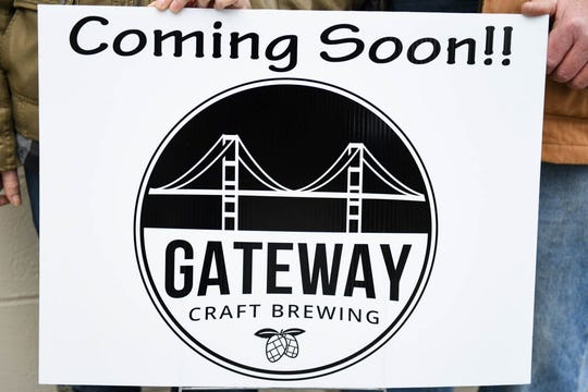 """Lynn and Tim Gavin of Hebron pose in front of the site of their new brewery, """"Gateway Craft Brewing"""" in Salisbury."""