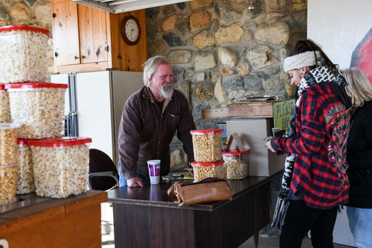 Bruce Nichols sells popcorn and trees to customers at Nichols Tree Farm in Hebron on Wednesday, Nov 29, 2018.