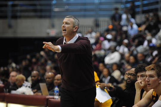 "Salisbury University head coach Brian McDermott signals to his players during the ""10-mile Tipoff"" against the University of Maryland Eastern Shore on Nov. 1, 2018."