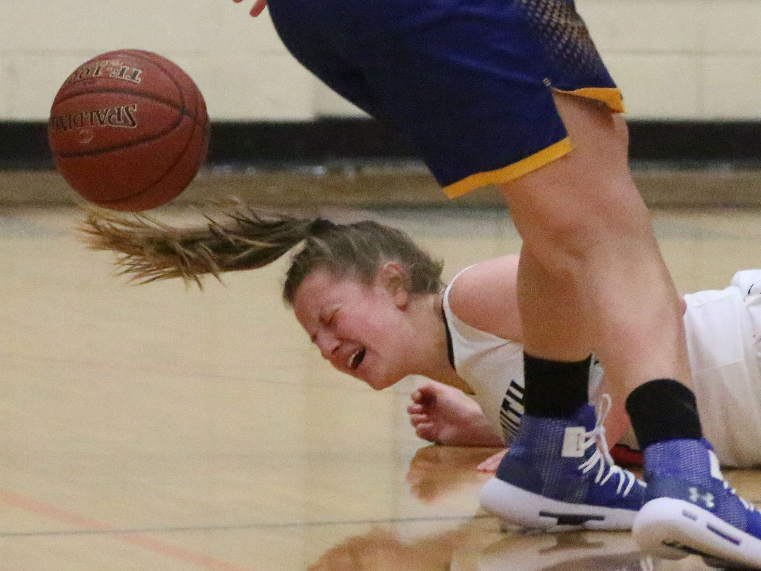 Plymouth's Alesha Kaat-Fohr (4) grimaces as she hits the floor during action with Campbellsport, Thursday, November 29, 2018, in Plymouth, Wis.