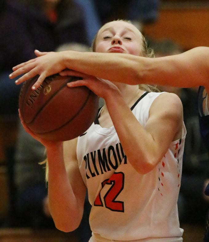 Plymouth's Ava Booth (12) grips the ball as a Campbellsport player's arm attempts to impede her shot, Thursday, November 29, 2018, in Plymouth, Wis.