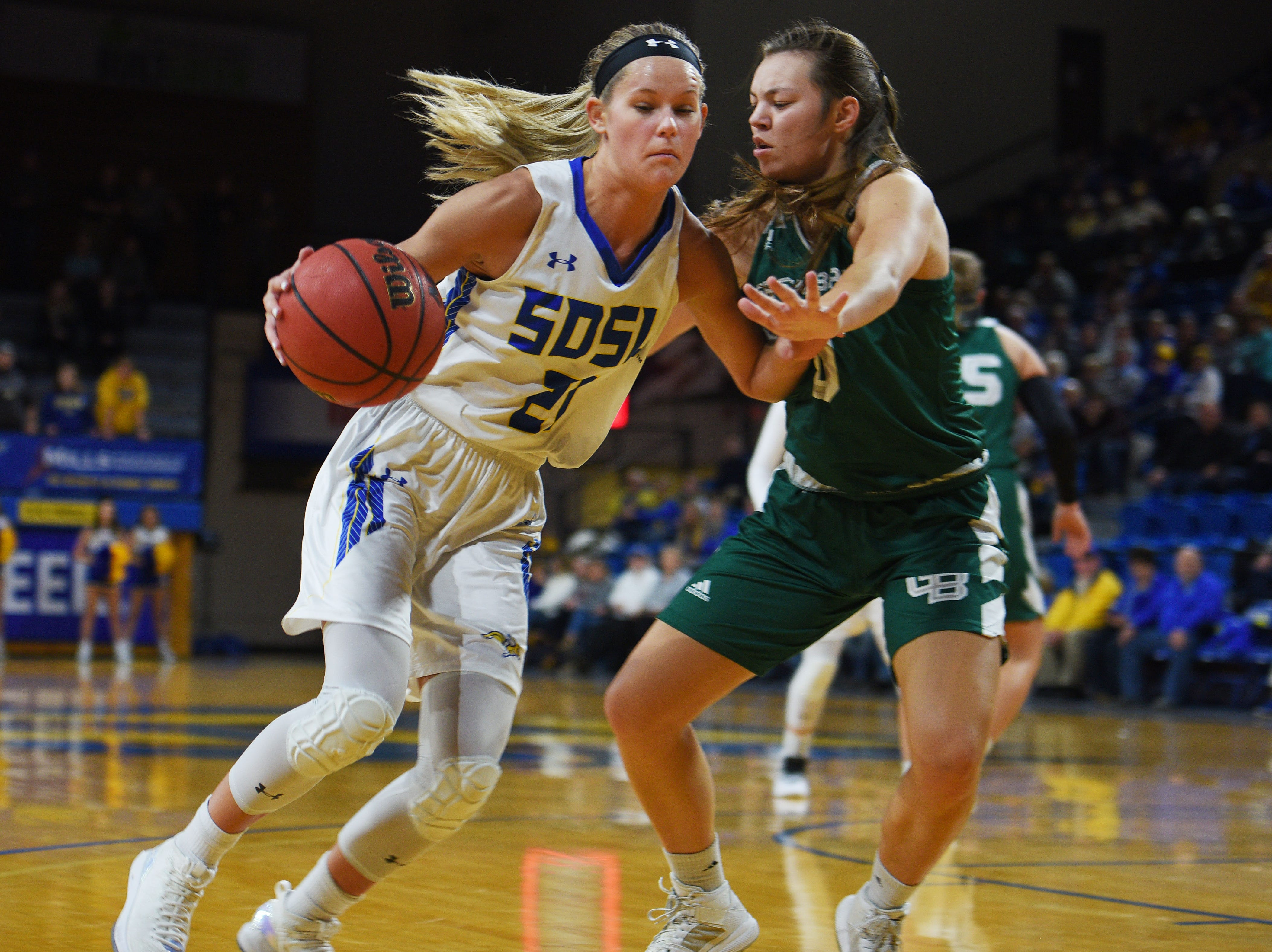 SDSU's Tylee Irwin goes against Green Bay's HaileyOskey during the game Thursday, Nov. 29, at Frost Arena in Brookings.