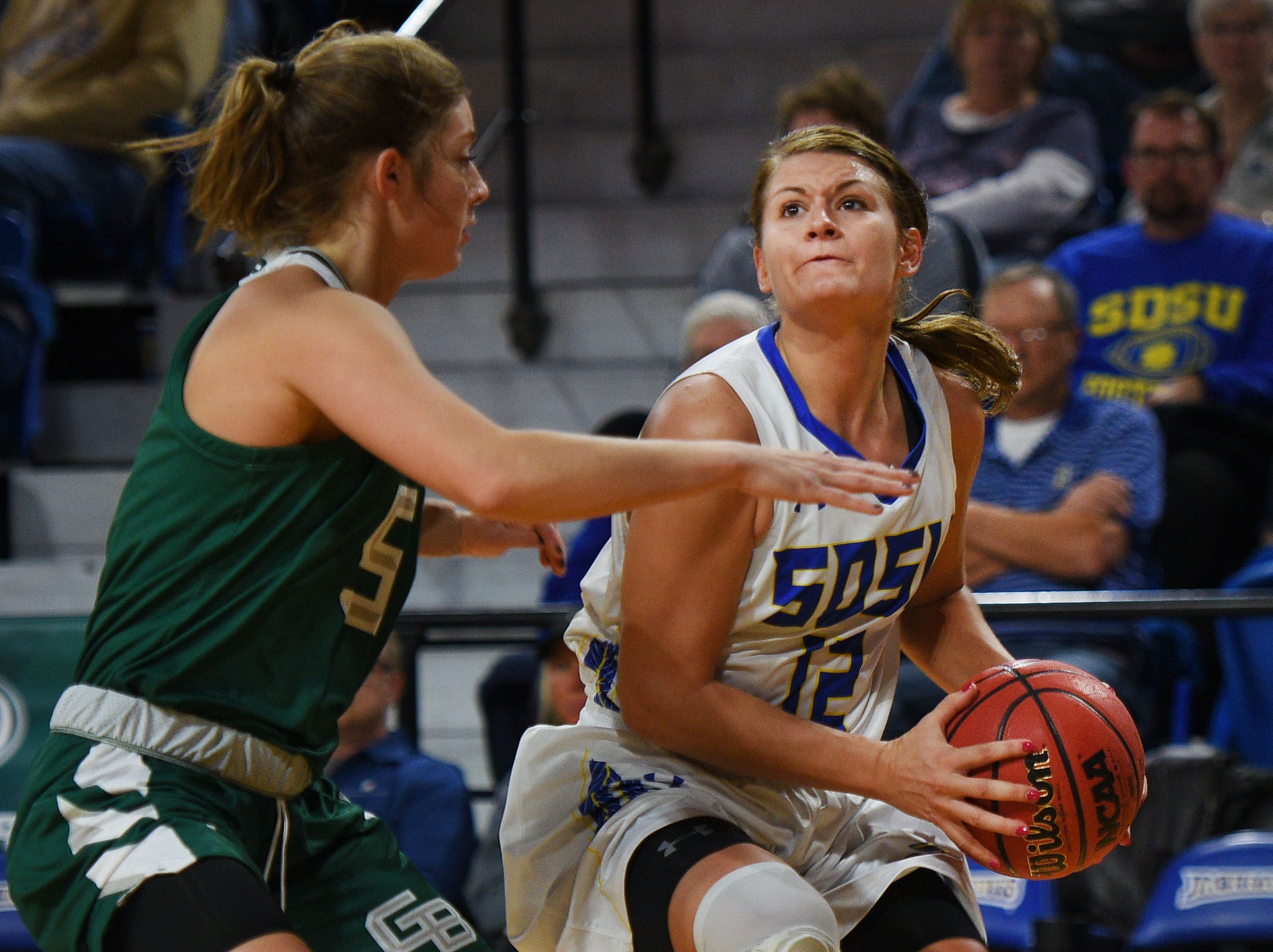 SDSU's Macy Miller goes against Green Bay defense during the game Thursday, Nov. 29, at Frost Arena in Brookings.