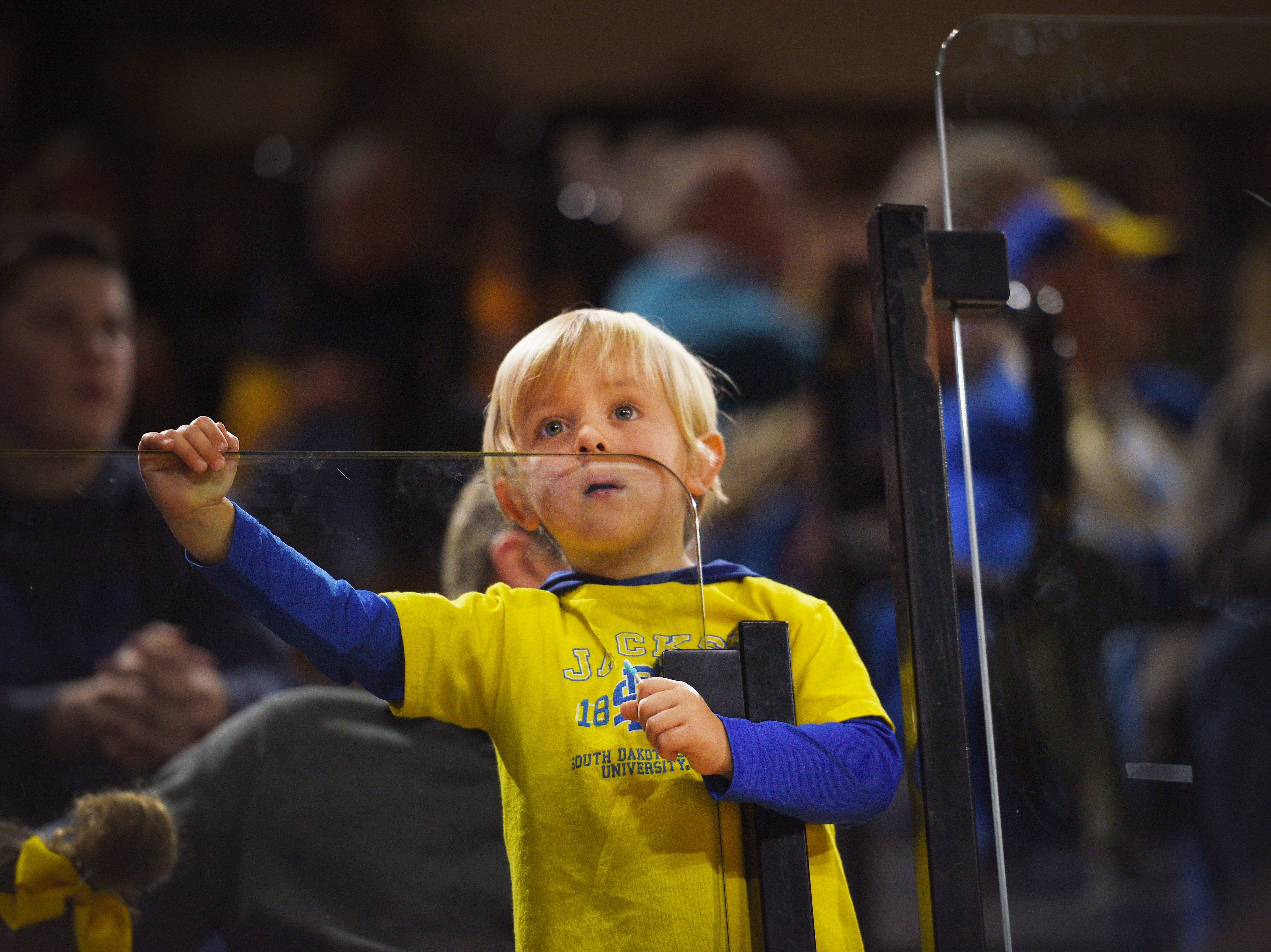 A young SDSU fan watches the game against Green Bay Thursday, Nov. 29, at Frost Arena in Brookings.