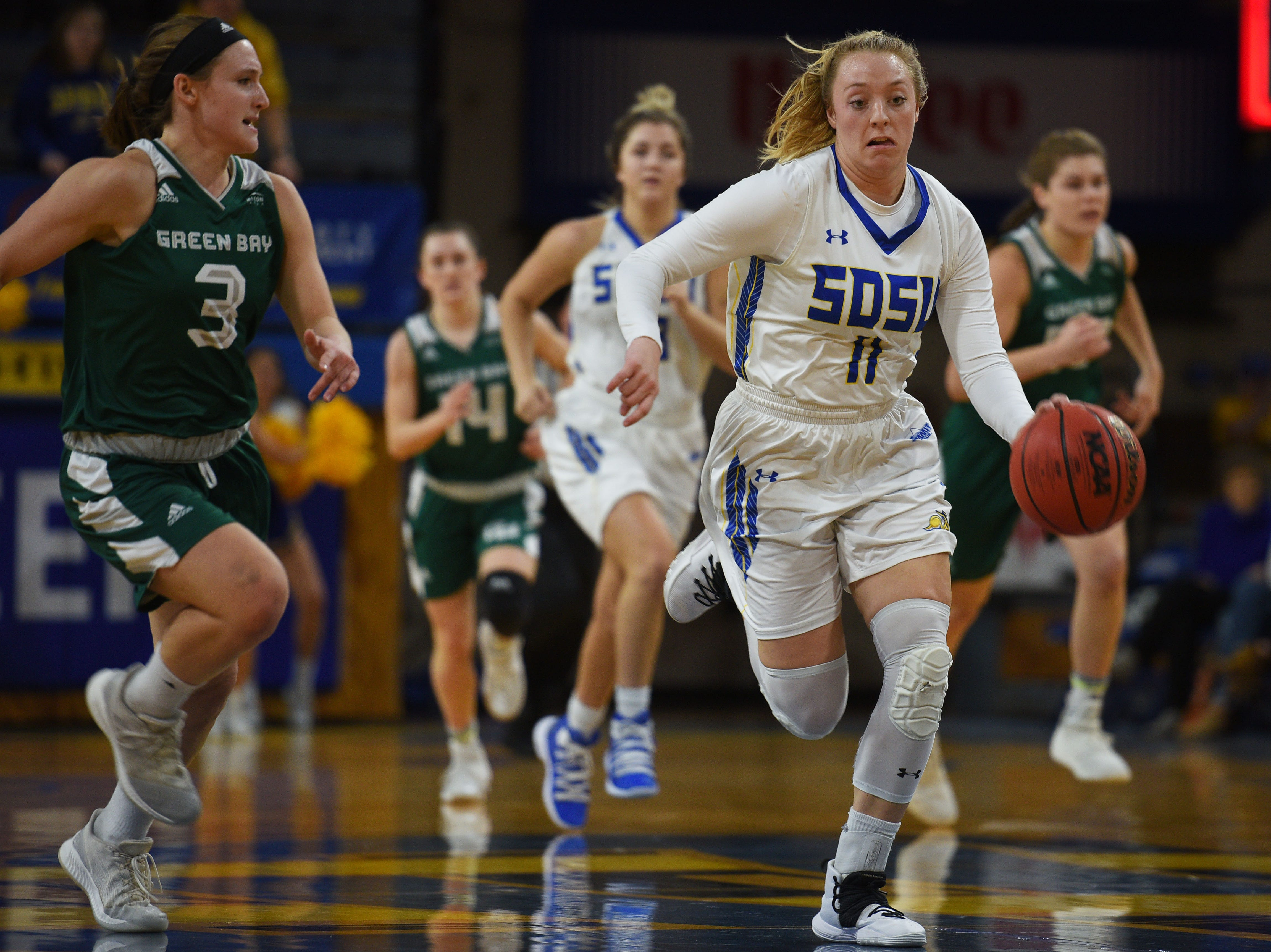 SDSU's Madison Guebert goes against Green Bay defense during the game Thursday, Nov. 29, at Frost Arena in Brookings.