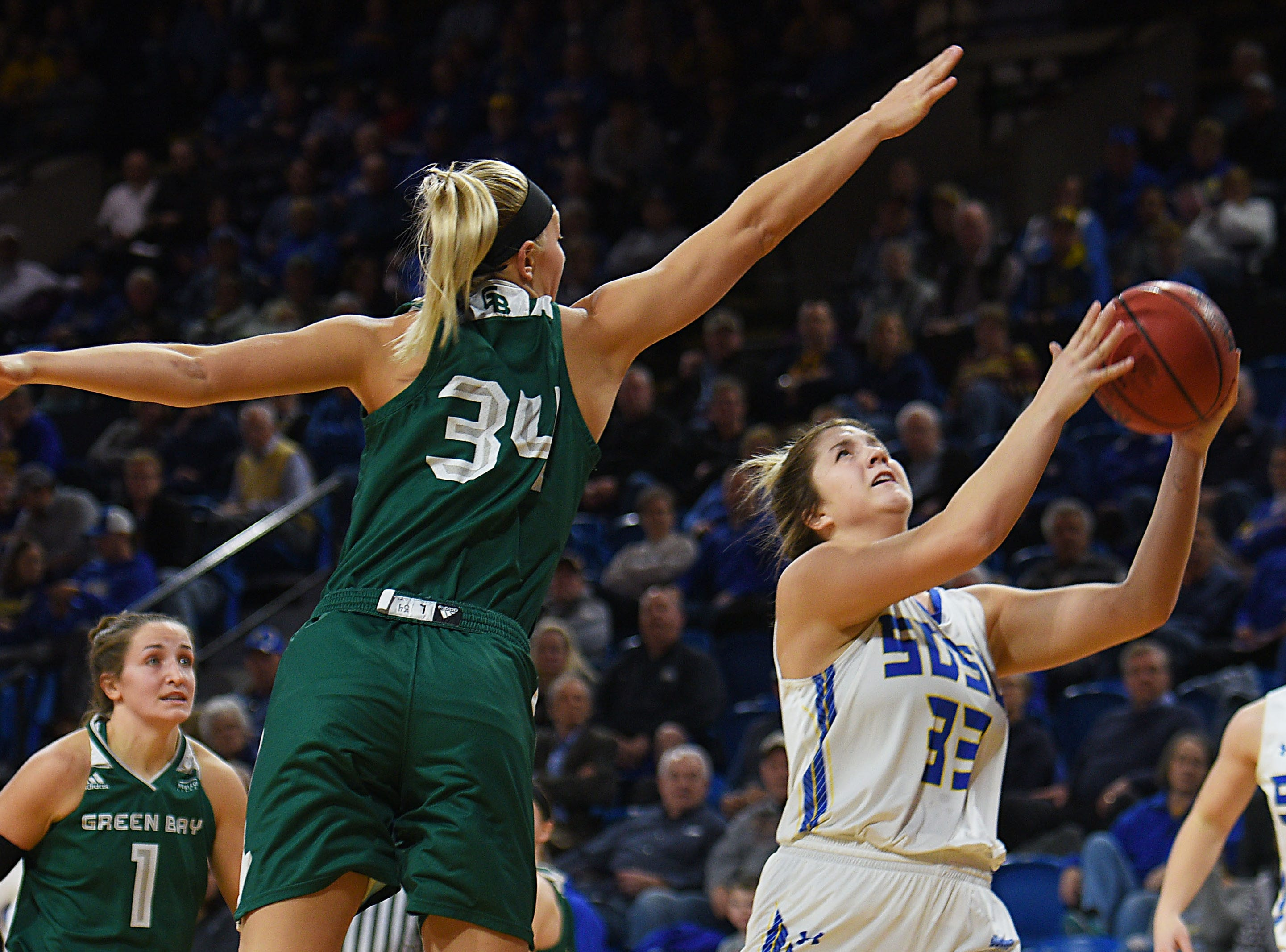 SDSU's Paiton Burckhard goes against Green Bay defense during the game Thursday, Nov. 29, at Frost Arena in Brookings.