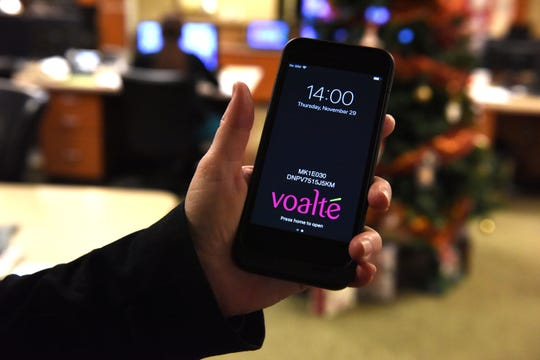 Candice Friestad, Avera Health's director of clinical informatics, holds up her phone with the app Voalte displayed, Thursday, Nov. 29, 2018 in Sioux Falls, S.D.