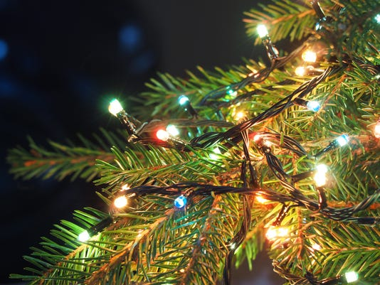 Christmas Lights On Christmas Tree Decorative Garland In Dark Space