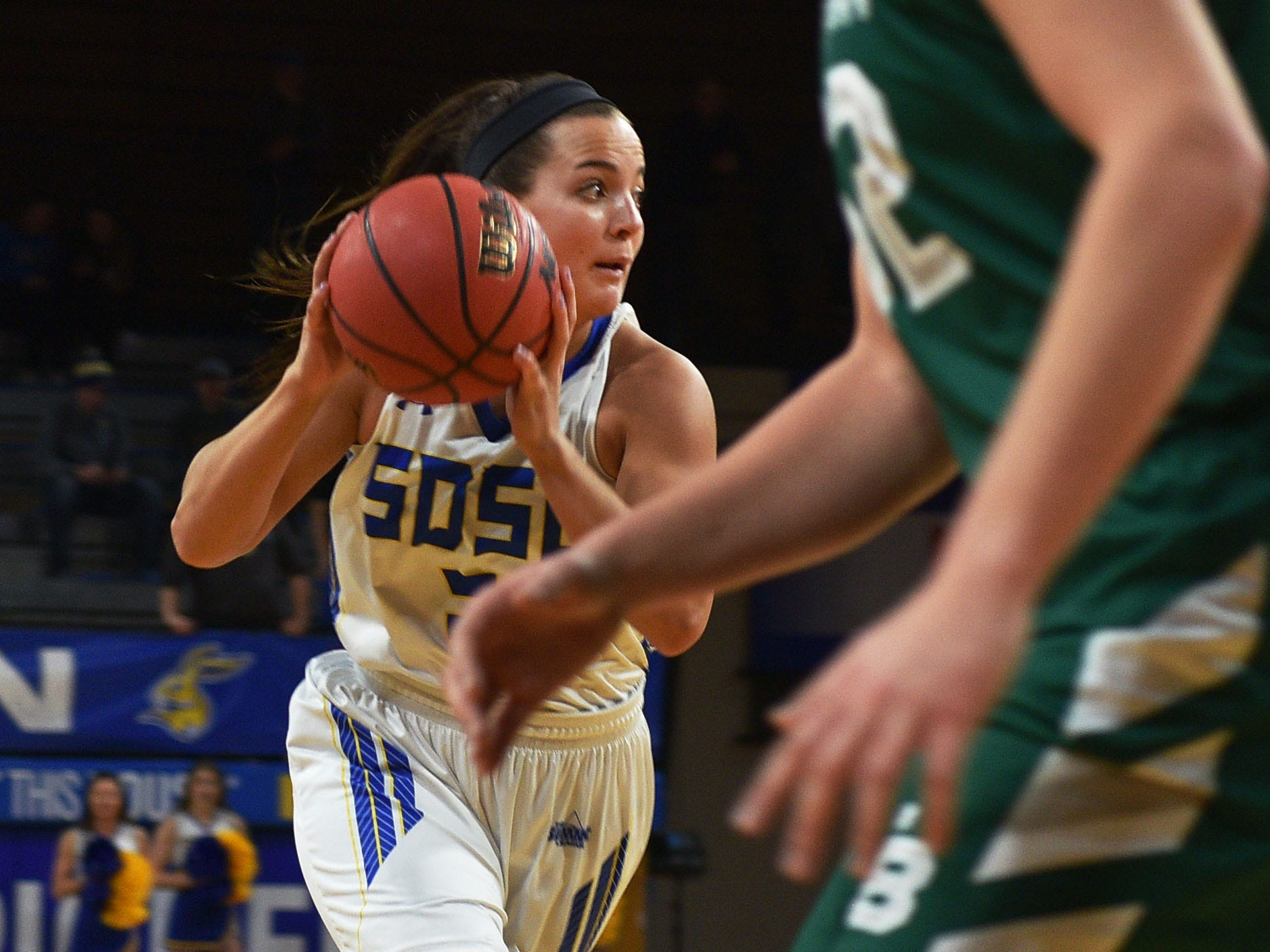SDSU's Lindsey Theuninck goes against Green Bay defense during the game Thursday, Nov. 29, at Frost Arena in Brookings.