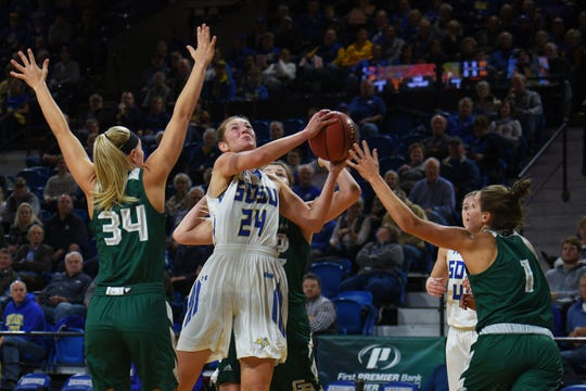 SDSU's Tagyn Larson goes against Green Bay defense during the game Thursday, Nov. 29, at Frost Arena in Brookings.