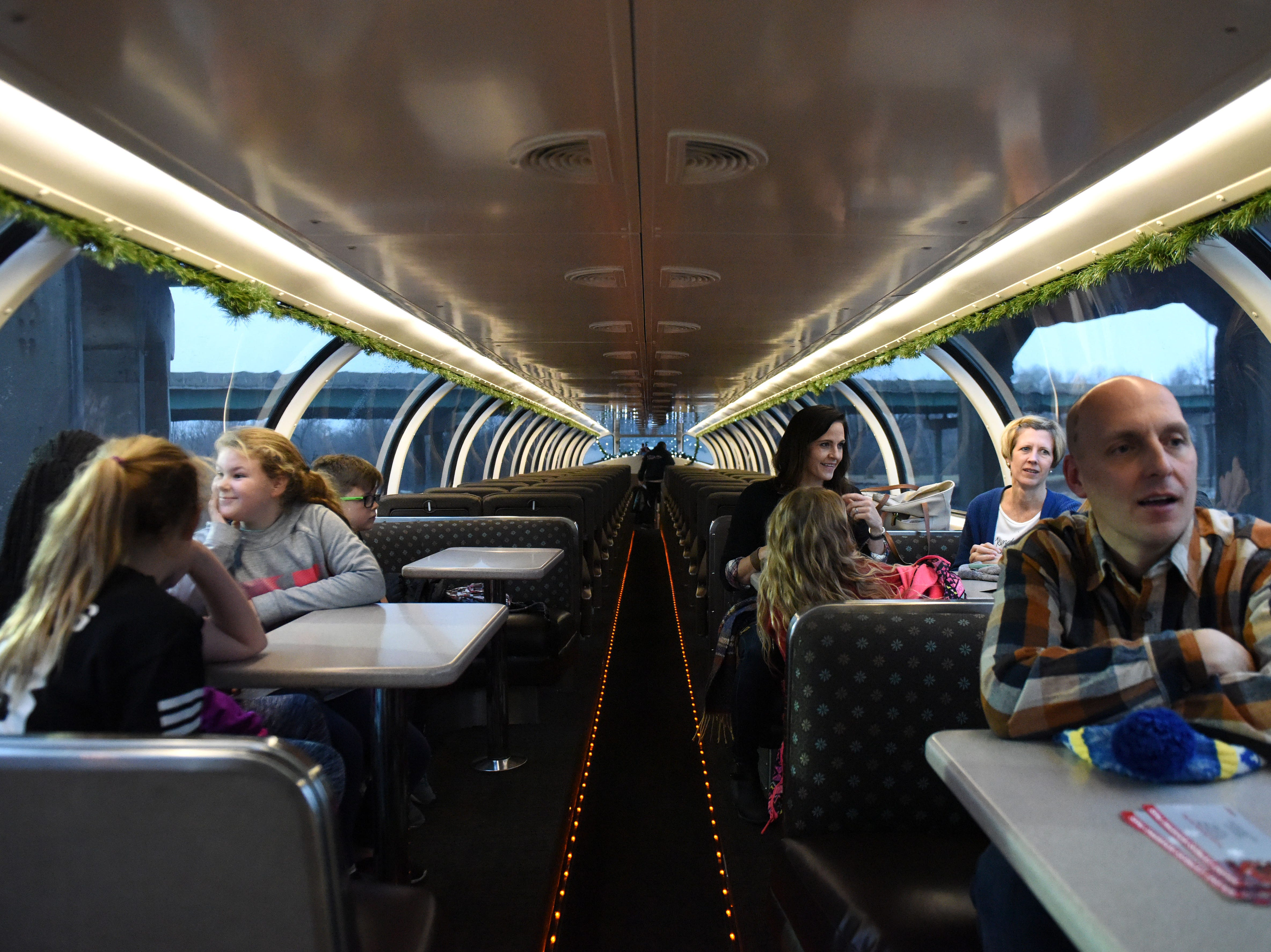 Families sit in the BNSF train in Sioux Falls, S.D., Thursday, Nov. 29, 2018.