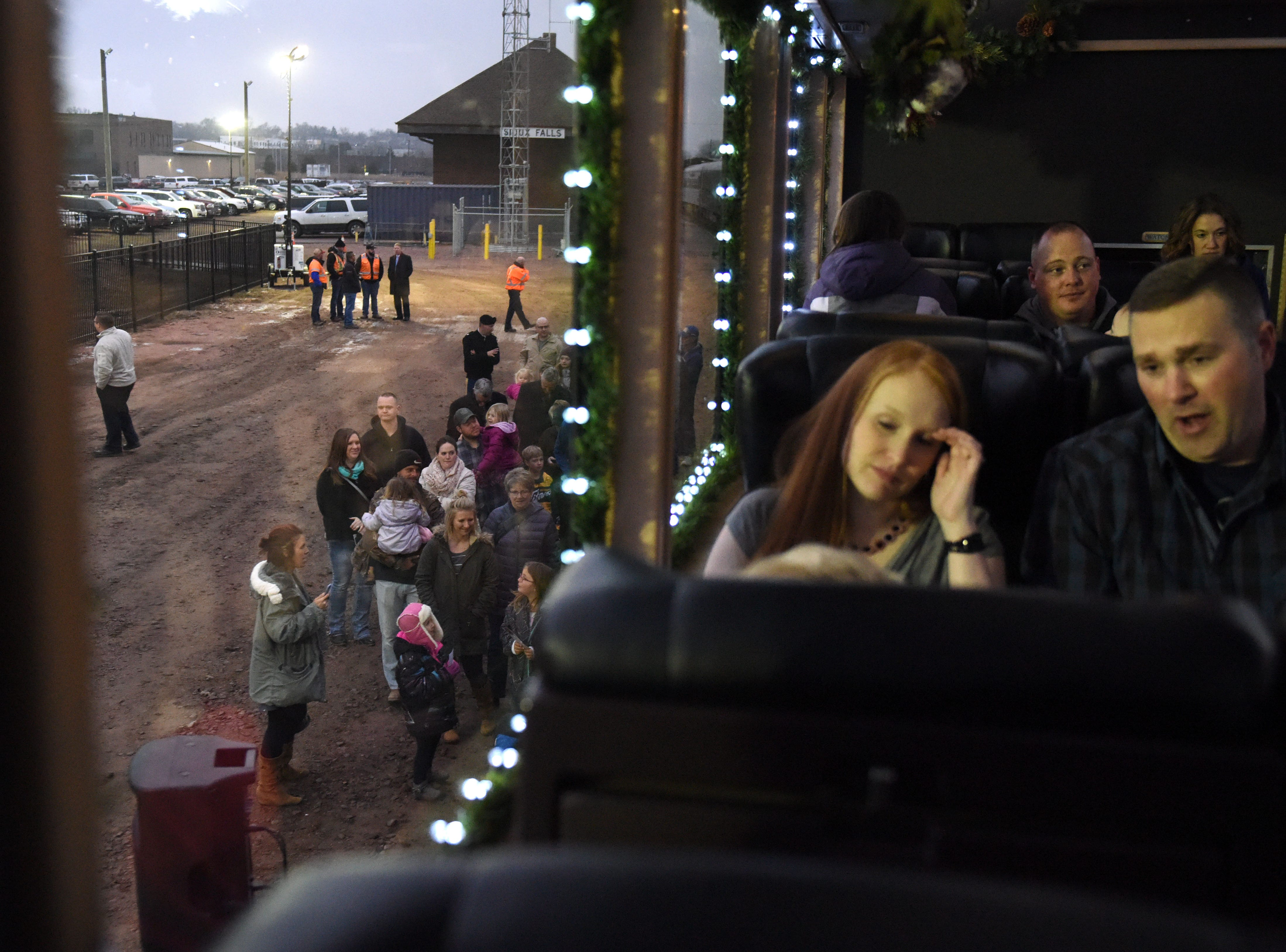 People wait in their seats as others board the BNSF train in Sioux Falls, S.D., Thursday, Nov. 29, 2018.