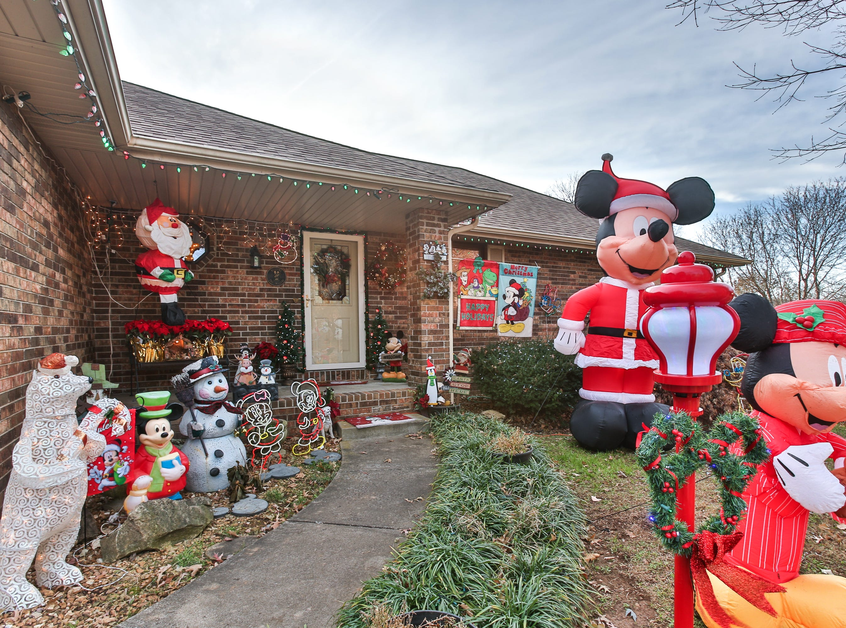 The Millers' affection for Christmas spills onto their lawn. This year, the Millers' home will be included in the News-Leaders roundup of the best home Christmas light displays.